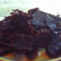 Beef Jerky Recipe - Thinly sliced eye of round steak is marinated with soy sauce, hot pepper sauce, and brown sugar, then baked at low temperature for 6 to 8 hours. This can be prepared without a food dehydrator.