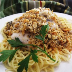 Poppy Seed Chicken Recipe - Sherry adds a sweet note to chicken baked in a sour cream sauce and topped with cracker crumbs and an abundance of poppy seeds.