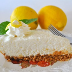 Lemon Icebox Pie III Recipe -  Cream cheese, condensed milk, lemon juice and rind is stirred up in a bowl until smooth, poured into a graham cracker crust, and then chilled.