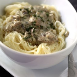 Fettuccine in Creamy Mushroom and Sage Sauce Recipe - Spinach fettucine is tossed with a distinctive cream sauce in this quick recipe!