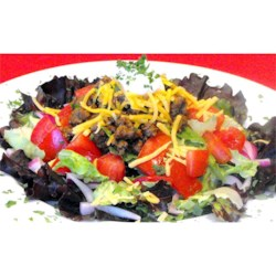 Sue's Taco Salad Recipe - This is a great dish for pot-lucks. It's easy, and can be made in advance. Add dressing just before serving.