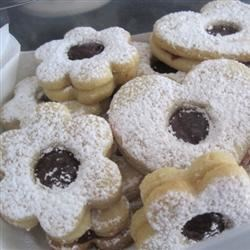 Linzer Tarts Recipe - Almond cut-out cookies with a raspberry jam filling.