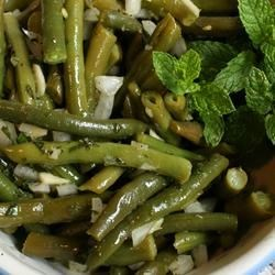 Minty Green Bean Salad Recipe - Green beans with a hint of mint are blended with a tangy vinaigrette.