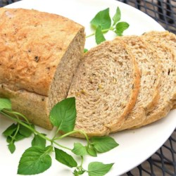 Whole Wheat Zucchini Herb Bread Recipe - This savory wheat bread is flecked with sesame seeds, rosemary and deep green zucchini.