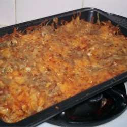 Cheesy Potato Kugel Recipe - Use your food processor to quickly shred potatoes for this savory kugel. Toss with eggs, salt, pepper, oil, onion and cheese. After baking for an hour, the dish gets a quick blast of high heat to give it a beautifully browned crust.