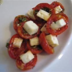 Roasted Roma Tomatoes Recipe - Hang onto those last lazy summer days with this easy recipe for roasted plum tomatoes, seasoned with fresh herbs and baked with feta cheese.