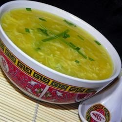 Chi Tan T'ang (Egg Drop Soup) Recipe - This is a simple soup in which beaten eggs are stirred into a chicken broth flavored with soy sauce and vinegar and chopped scallions.