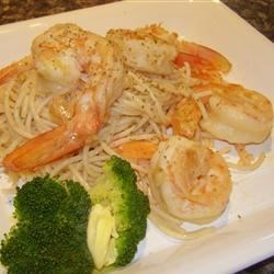 Garlic Pasta with Prawns Recipe - This is a nice change from regular old pasta with tomato sauce. You can serve a large portion as a main dish, or I've even used this as my 'salad' at dinner parties. Really simple!