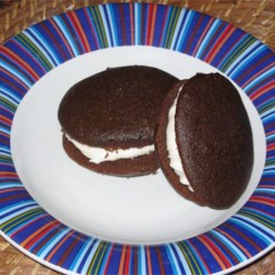 Whoopie Pies IV Recipe - These chocolate cake cookies feature a creamy vanilla filling.