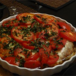 Balsamic Chicken and Fresh Mozzarella Recipe - Marinated chicken breast halves are pan-fried and layered with tomato, basil and fresh mozzarella for an elegant and lovely meal.
