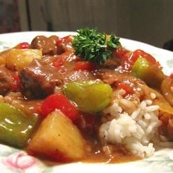 Slow Cooker Island Beef Recipe - Sweet and sour beef with pineapple, red and green bell peppers, and fresh tomatoes is easy to make in the slow cooker.