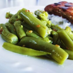 Sesame Green Beans Recipe - Fresh green beans are sauteed with sesame seeds and olive oil, then gently simmered with chicken broth.