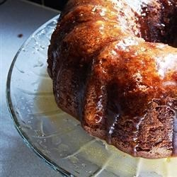Apple Harvest Pound Cake with Caramel Glaze Recipe - Apples and walnuts are folded into a cinnamon-spiced cake. This is a fantastic Bundt cake that my grandmother used to make for Thanksgiving. It has been a family favorite for years!