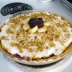 Blueberry and Banana Cream Cheese Pie Recipe -  This recipe makes two amazing pies that freeze perfectly. Move over Sara Lee. Pecans are pressed into a pie shell and baked. Then sliced bananas are put in, covered with a fabulous cream cheese mixture, and topped with blueberry pie filling.