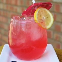 Hot Pink Lemonade Recipe - Refreshing, fun recipe for blueberry lemonade! Tart and sweet  from the blueberries. The finished drink is hot pink, almost purple. Garnish with a slice of lemon.