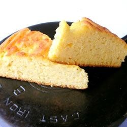 Cornbread I Recipe - Yielding an old-fashioned, dense cornbread that bakes in the skillet, this is the tried-and-true formula of buttermilk and cornmeal.