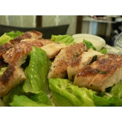 Lime Grilled Chicken Caesar Salad Recipe - Marinated chicken grilled then sliced and served on your favorite salad greens with a topping of parmesan cheese and croutons with creamy Caesar salad dressing.  Your man will love it!