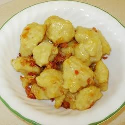 Potato Dumplings with Bacon and Onions Recipe - These delicious potato dumplings have become a family tradition. Served with beef or pork roast, they are delicious with or without gravy. They are a little time-consuming but well worth the wait.