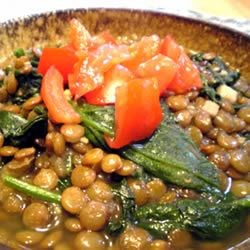 Lentils And Spinach Recipe - This is my own adaptation of an Indian recipe.   It doesn't look like much, but it is surprisingly yummy. Serve this for dinner over hot rice or a diced baked potato.  Pair with carrots, cauliflower, or a fresh sliced tomato for a full meal.