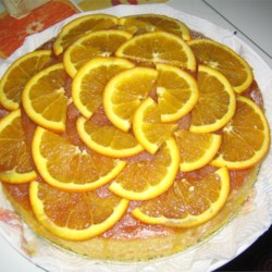 Orange Kiss-Me Cake Recipe - A whole orange is ground up and added to this cake along with raisins and walnuts. A delightful fruit filled cake!