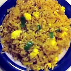 Poor Man's Fried Rice Recipe - This is a quick and easy version of an all-time favorite.  Instant rice is cooked with scrambled eggs, soy sauce, ginger and green onions.