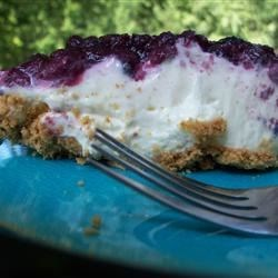 Easy Cream Cheese Pie Recipe - Sweetened condensed milk makes this pie velvety, and the lemon juice compliments the cream cheese beautifully. Along with the cream cheese, these ingredients are stirred together, poured into a graham cracker crust, topped with cherry pie filling and chilled.