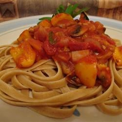 Tomato and Basil Pasta Sauce Recipe - Fresh basil is added to a sauce made of canned tomatoes simmered with balsamic vinegar, sugar, and red pepper flakes.
