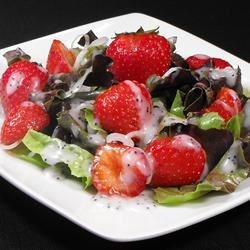 Strawberry Onion Salad Recipe - Strawberries on a bed of red leaf lettuce, garnished with red onions for a stunning color combination. An unusual sounding recipe that turns people off until they taste it, then they love it.