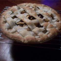 American Apple Pie Recipe - Brown and white sugars, raisins and lemon juice add a wonderful taste and texture to this quintessential apple pie. Be sure to cube or slice the apples uniformly, and, if you like, dot the apples with pats of butter.