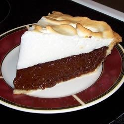 Bev's Chocolate Pie Recipe - Sweet and creamy, this chocolaty pie is topped with a meringue, and baked until the filling is set and the billowy topping is tinged with gold.
