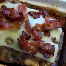 Bacon Mushroom Swiss Meatloaf Recipe - This meatloaf is full of flavor, and a delicious twist on an old favorite. Bacon, onions, mushrooms, and Swiss cheese are added to ground beef and baked to perfection.