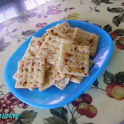 Alabama Fire Crackers Recipe - Saltine crackers soak in spices overnight, including plenty of hot red chili flakes, until they are mighty hot. Serve with chili.