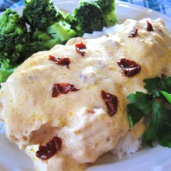 Creamy Chipotle Chicken  Recipe - An easy, creamy chicken dish made in the slow cooker gets a smoky kick from chipotle peppers. It's nice to serve with hot cooked rice.