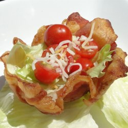 BLT Bacon Bowls Recipe - A crisp bowl made of bacon with lettuce and tomato inside. Great for appetizers or a party. Served room temperature, these are sure to be a hit!