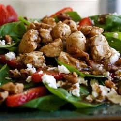 Spring Strawberry Salad with Chicken Recipe - Fresh spinach leaves are topped with crumbled goat cheese, strawberries, candied pecans, and savory chicken breast meat in a salad that works as either a side dish, lunch, or a light supper.