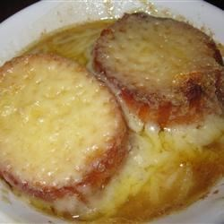 French Onion Soup I Recipe and Video - Thick slices of French bread are toasted in the oven and placed on top of each bowl of rich onion soup. Slices of  Swiss cheese are melted over the toast.