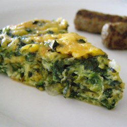 Crustless Spinach Quiche Recipe - A quick and easy crustless spinach quiche recipe that uses eggs, spinach, onion, and Muenster cheese for the perfect quiche in less than an hour.