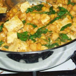 Spinach Chickpea Curry Recipe - A quick delicious Indian-style curry with spinach, chickpeas, onions, and/or whatever veggies you have.  I have added cauliflower, potatoes, and sweet potatoes to this recipe in the past.  All were very good.  Serve with nan, pita or rice if desired.