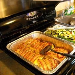 Bacon-Wrapped Salmon Recipe - What more is there to say? The salmon stays really moist from the bacon, and the skin helps protect the bottom from cooking prematurely.