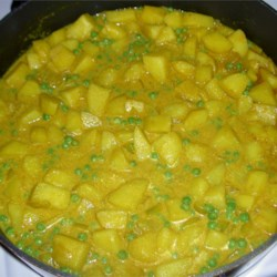 Potato Curry Recipe - This is a great creamy curry recipe. It is very mild, and unlike typical curries. A crowd pleaser!