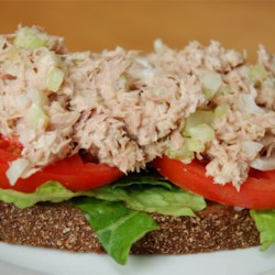 Zesty Tuna Salad Recipe -  Sweet dill pickles and Dijon mustard give this tuna salad a bit of kick. And if you 've never tried making your tuna sandwich with nice thick slices of raisin bread, then why not give it a try. It 's wonderful. Really!