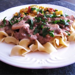 Easy Beef Stroganoff Recipe - A lusciously tart sauce of sauteed mushrooms, onions and sour cream is beefed up and served over tender egg noodles. Hint: do not bring the sour cream sauce to a boil.