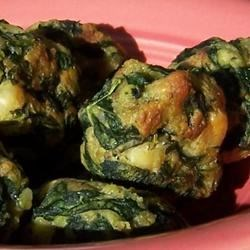 Spinach Appetizers Recipe - Instead of sausage balls, try these savory spinach treats -- they're great! The recipe was given to me while shopping by a lady at the grocery store. The formed balls may be stored frozen in airtight containers until ready for use.