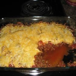 Taco Bake I Recipe - Browned ground beef mixed with dried taco seasoning is layered in a casserole with canned refried beans and salsa. It is topped with shredded Monterey Jack cheese and baked for 20 to 25 minutes.