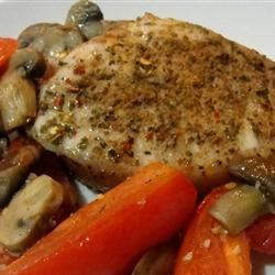 Roasted Pork Chops with Tomatoes, Mushrooms, and Garlic Sauce Recipe - Tender pork chops are given a flavorful spice rub and roasted with tomatoes and sliced mushrooms.