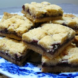 Czechoslovakian Cookies Recipe - These bar cookies are made with a not-too-sweet pecan shortbread spiced with cardamom, with a jam filling. They're perfect with coffee or tea.