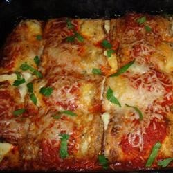 Awesome Eggplant Rollatine Recipe - Thinly sliced eggplant is lightly fried, then stuffed with a spinach and cheese mixture and baked with pasta sauce and mozzarella cheese.