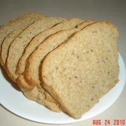 Uncle Wynn's Bread Machine Rye Recipe - Almost equal proportions of rye and bread flour make for a hearty rye flavor in this softly honeyed loaf that 's speckled with caraway seeds.