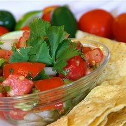 Fresh Tomato Salsa Recipe - Finely chopped Serrano chilies make this salsa nippy and nice. Combine with tomatoes, onions, cilantro and lime juice, and this salsa is ready for dipping.