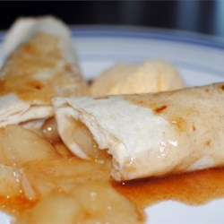 Apple Enchilada Dessert Recipe - Apples rolled in flour tortillas. VERY delicious, easy and fast to make. Substitute apples with peaches or cherries if desired.